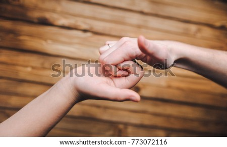 The hands of friends who greet each other at the meeting. Joke. A cheerful greeting. The game. #773072116