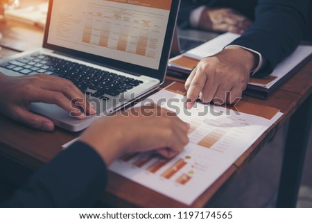 The hands of the business woman and the consultant are checking the data ang information for marketing planning. #1197174565