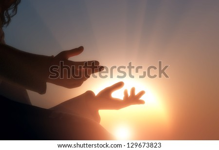 The hands of the religious man.