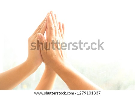 The hands of three people together to show cooperation and unity, unity is power. #1279101337