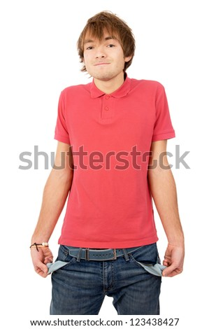 the handsome young man turned his pockets out and shows that he has nothing isolated on white background