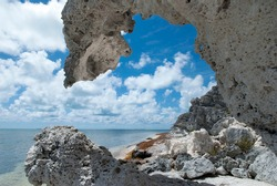The hanging rock creating an arch, the eroded formation on Grand Turk island beach (Turks and Caicos islands).