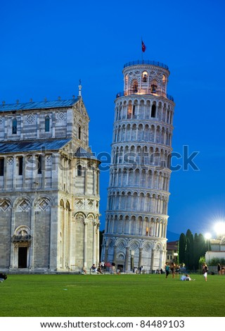 The hanging tower of Pisa with cathedral after sunset