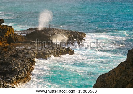 The Hanole blowhole on the southeast end of Oahu, Hawaii - stock photo