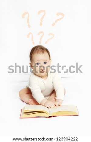 The happy baby with the book.