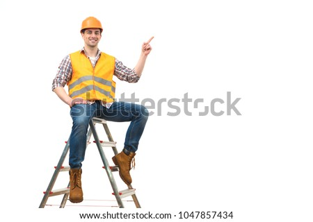 The happy builder on the ladder gesturing on the white background