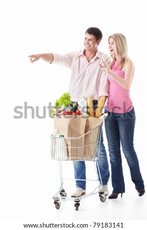The happy couple with a cart with food on a white background