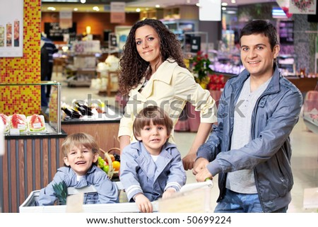 The happy family in shop looks in the chamber