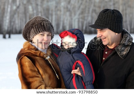 The happy family posing outdoor in winter, Siberia