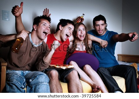 The happy fans  watching TV - stock photo