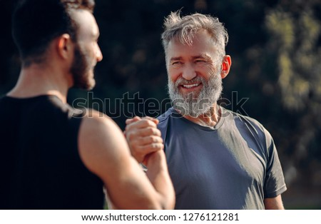 The happy father and son greeting outdoor
