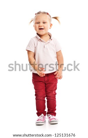 the happy little child posing in studio