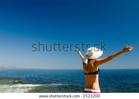 The happy woman on a beach