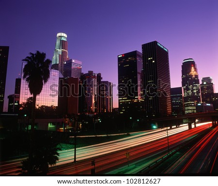 The Harbor Freeway with Los Angeles skyline at night, California