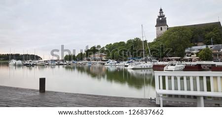 The harbor in Naantali, Finland, popular tourist destination outside Turku. Naantali Church from the 15th century.