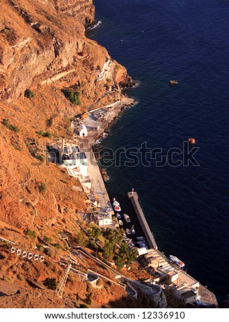 The harbour at Fira, Santorini, seen from the cliff top, with the cable car in action in the foreground