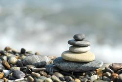 the harmony pyramid of stones on a gravel beach sea