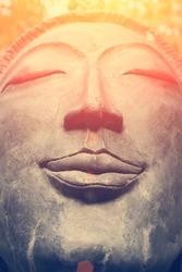 The head of a Buddha statue.