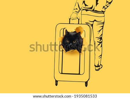 The head of a funny black cat peeks out of a ragged hole in yellow paper on which a big suitcase and a woman rolling it around the station are drawn.The concept of transportation,pets in travel.Scetch Foto d'archivio ©