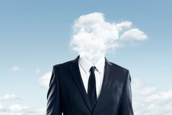 The head of the businessman is covered with clouds , business concept .