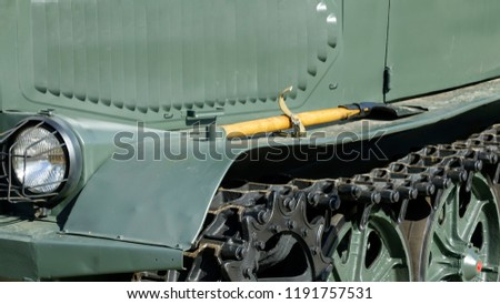 The headlight of a headlight of an old retro-rover on a caterpillar course of green color #1191757531