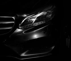 The headlight of a modern, executive car.