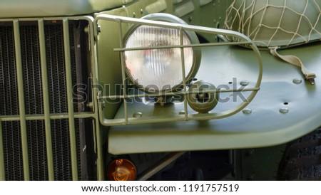 The headlight of the headlight of the old cargo retro car is green #1191757519