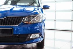 The headlights and hood Blue sports car