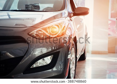 The headlights and the hood of a black sports car. #388748860