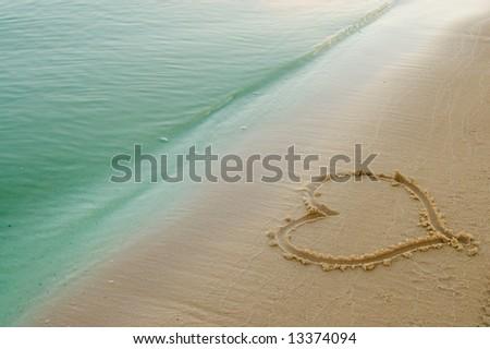beach sand. the heart on each sand