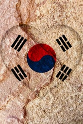 The heart shape flag symbol of South Korea isolated on weathered red solid rock wall background, strong and positive South Korea national flag texture wallpaper