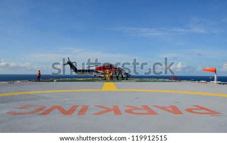 The helicopter refueling on oil rig