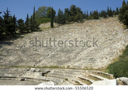The Hellenistic Theater at Argos. Built in the 4th century BC, it held 15,000 spectators on the seats hewn from the rock; there were marble places for honored persons  - Perloponnese Greece