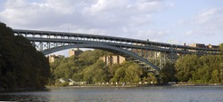 The Henry Hudson Bridge connects the Spuyten Duyvil section of The Bronx with the northern end of Manhattan to the south in New York.