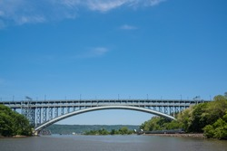 The Henry Hudson Bridge is a Double-decked arch Bridge in New York City across the Spuyten Duyvil Creek.The bridge has two roadway levels carrying seven traffic lanes and a pedestrian walkway.