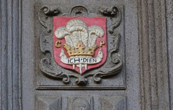 The heraldic badge of the Prince of Wales' feathers on the Great Gate to the Bodleian library in Oxford they are ostrich feathers and the emblem of the Black Prince with motto ich dien meaning I serve