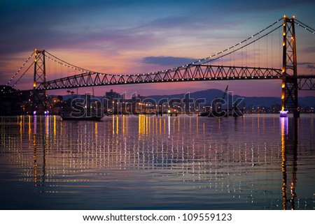 The Hercilio Luz Bridge, in Florianopolis, Brazil, with an amazing sunset.