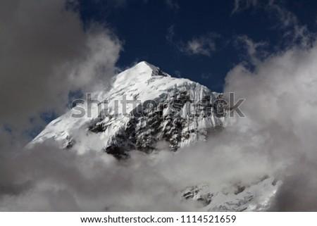The highest peak of Bhutan Chomolhari is 7,326 meters. View from mountain pass Nyele. Jigme Dorji National Park. Asia. Stock fotó ©