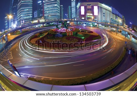 The highway bridge light trails on the modern building background in shanghai china