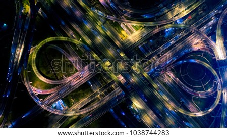 The highway in the big city, expressway enter the city, blue light picture by drone on top view.