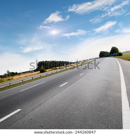 The highway traffic in sunset near fields #244260847