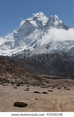 The Himalaya peak Ama Dablam (6814 m) - Mt. Everest region, Nepal - stock photo