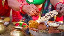 The hindu puja rituals feast platter (puja prasad, puja bhog) closeup. Sacred food to offer God on religious festival.