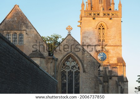 The historic Gothic St Bartholomew's Church in the quaint village market town of Corsham, Wiltshire in the Cotswolds, England during golden hour on a summer evening. Stock photo ©