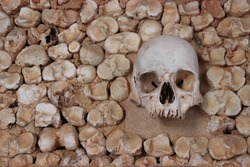 The historic portuguese chapel Capela Dos Ossos next to Igreja do Carmo in Faro at Algarve in Portugal is famous for its old wall graves and tombs with spooky bones and skulls of dead carmelite monks.