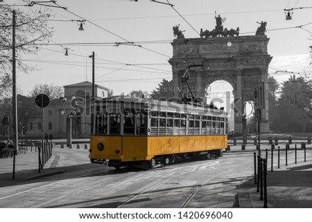 The historic yellow Tram in Milan in a pic Black and white - Italy
