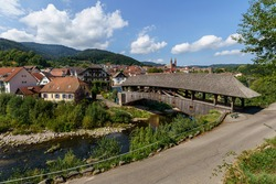 The historical wooden bridge with the Protestant church in Forbach, Black Forest, Baden-Wuerttemberg, Germany, Europe