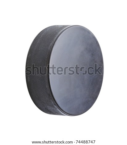The hockey puck isolated on a white background