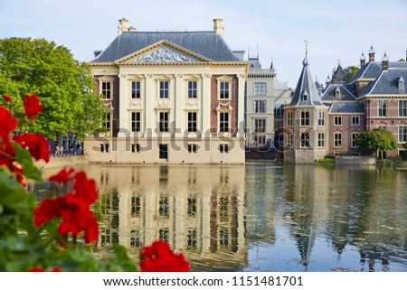 The 'Hofvijver' (Court Pond) with the buildings of the 'Binnenhof' (Inner Court), 'Het Torentje' (The little Tower, office of the Prime Minister) and 'Mauritshuis' (museum), the Hague, the Netherlands