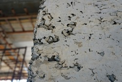 The hole or gap on the surface of the concrete post is caused by uneven cement. Problems that are most common in building construction